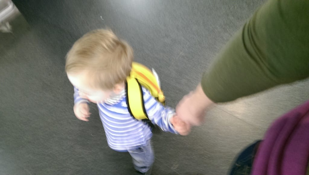 toddler with backpack