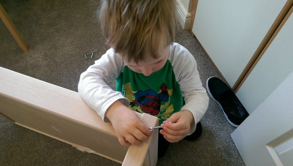 3-year-old flat pack assembly